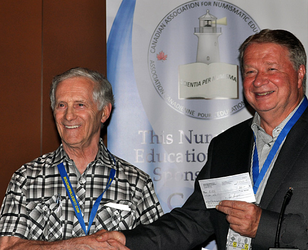 Pierre Leclerc presenting a donation to CAFNE
